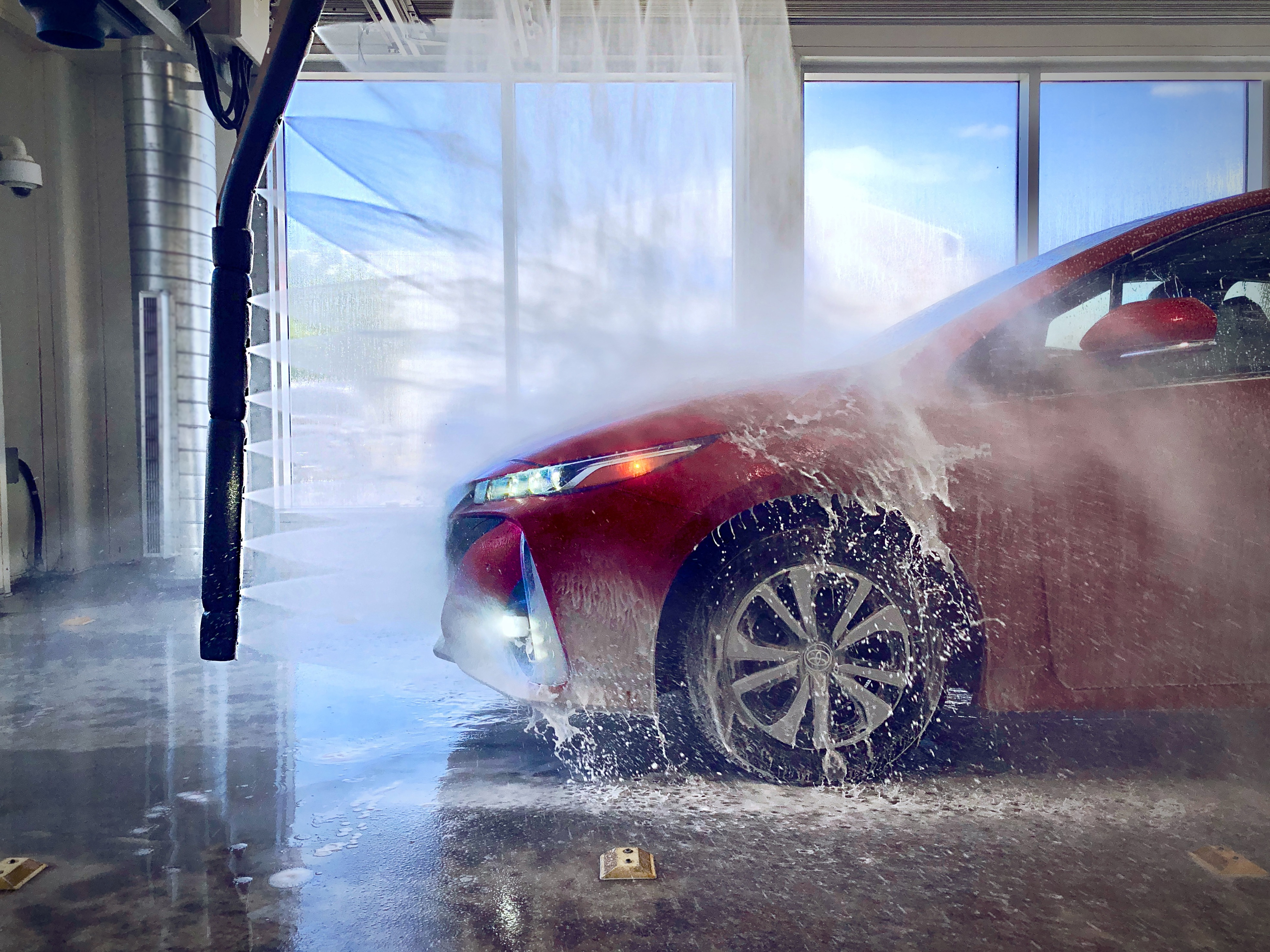 Touchless Complimentary Car Wash at every service